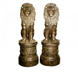 Bronze Sitting Lions on Round Pedestals Sculpture Pair